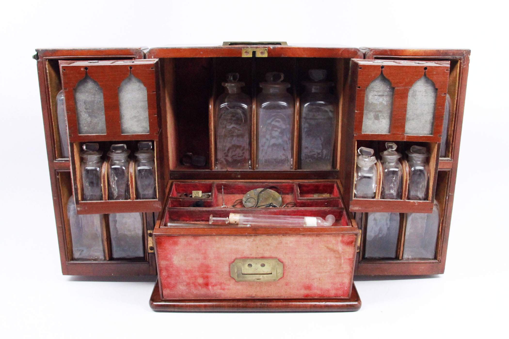 A DOMESTIC APOTHECARY MEDICINE CHEST WITH UNIQUE INTERIOR DOUBLE DOORS  BEAUTIFULLY UPHOLSTERED MADE OF SOLID MAHOGANY WOOD CIRCA EARLY TO MID  1800S.